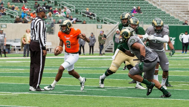 Quarterback Justice McCoy finds some open room to run during CSU's Green and Gold Spring Game on Saturday.