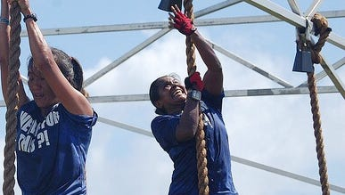 In this file photo, Blanda Camacho rings the bell after a rope climb at KONQER.