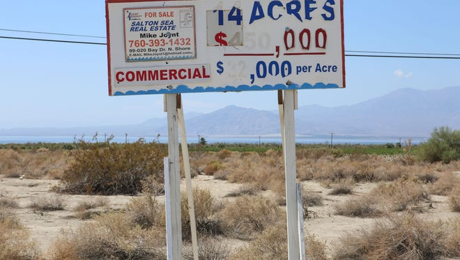 A weathered sign for commercial real estate at the Riverside County community of North Shore along the Salton Sea.