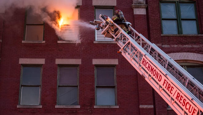 A window frame burns at Fourth Floor Blues Club on the top story of the Parker Co. building, 923 N. E St., on Saturday, June 23, 2018.