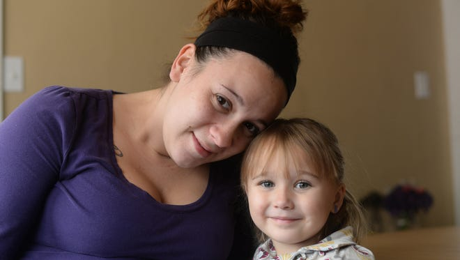 Kamie Rein, a House of Hope graduate, poses with her daughter Karma Dumas in their Clay Street home Nov. 6, 2014.