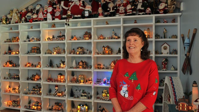 Ruth Laumer poses with the collection she and her husband began about 20 years ago. Every year, they assemble Willowwood Village, comprised of 36 homes, many of which share names with their family members. LEFT: Many of the buildings included in Willowwood Village reflect the Laumer's interests. Because Ken and Ruth enjoy line dancing, they include this Christmas Barn Dance. BELOW RIGHT: The Laumers are often inspired to purchase Willowwood additions that already have names of their loved ones. For example, Paul's Pub for their grown grandson Paul.