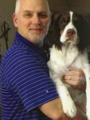 Bill Bryant with Riley, the family dog. Bill died from cancer in 2015.