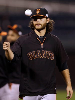 Giants shortstop Brandon Crawford tosses a ball in the air during a workout Monday in Kansas City, Missouri. The Giants and Kansas City Royals are scheduled to play Game 6 of the World Series on Tuesday night.