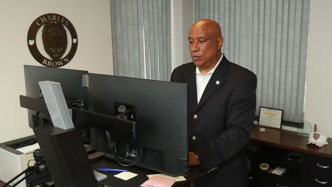 Charles A. Brown, Akron deputy mayor of public safety, works in his office Thursday.