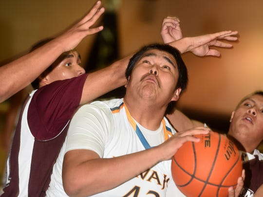 Navajo Prep's Anthony Pioche-Lee attempts a shot after coming up with an offensive rebound during a game between the Eagles and the Ramah Mustangs on Wednesday at the Eagles Nest.