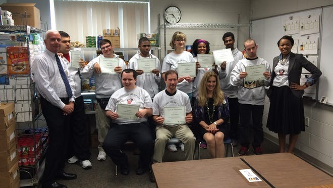 Students at Visions Unlimited who work with the Bountiful Backpacks program were honored Thursday for their service.