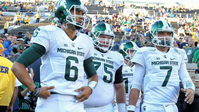 With Brian Lewerke out for the season, Michigan State will ride quarterbacks Tyler O'Connor (7) and Damion Terry (6) the rest of the way.