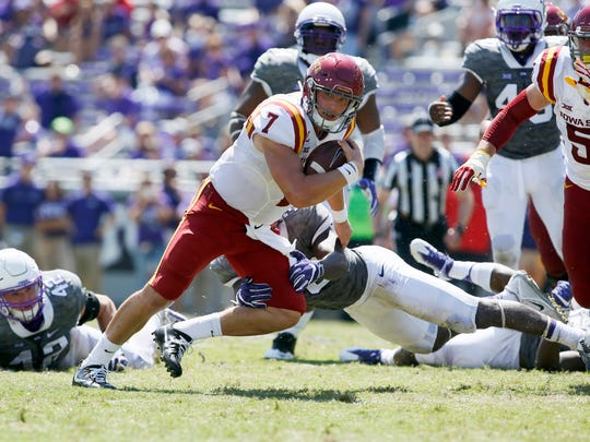 Iowa State quarterback Joel Lanning scrambles against Texas Christian on Saturday. Lanning completed 12-of-21 passes for 127 yards; he ran for 31 yards.