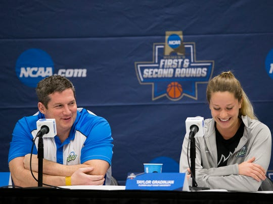 FGCU head coach Karl Smesko and junior guard Taylor Gradinjan share a laugh during a press conference at the Watsco Center Friday, March 17, 2017 in Coral Gables, Fla. FGCU takes on the University of Miami in the first round of the NCAA tournament Saturday.