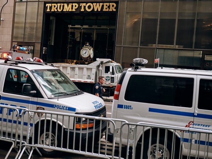 Police patrol Trump Tower during a demonstration against