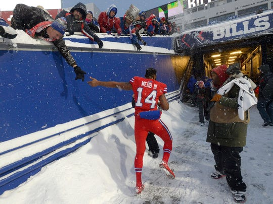 Buffalo Bills quarterback Joe Webb greets fans after an NFL football game Indianapolis Colts, Sunday, Dec. 10, 2017, in Orchard Park, N.Y. The Bills beat the Colts in overtime 13-7. (AP Photo/Adrian Kraus)