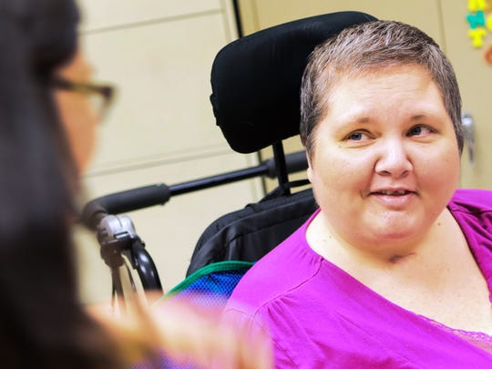 Dee Loner, right, of Honea Path smiles while working with occupational therapist assistant Amanda Barrieau at the Roger C. Peace Rehabilitation Hospital in Greenville.