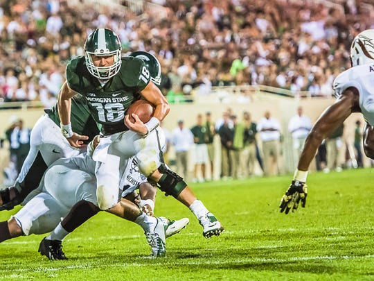 Michigan State quarterback Connor Cook (18) has come a long way since facing Western Michigan as a backup in 2013.