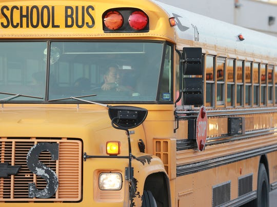A Socorro Independent School District bus leaves the