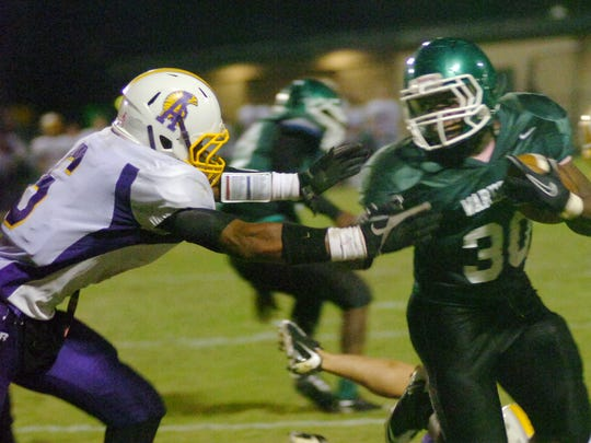 Peabody running back Jalen Richard tries to escape