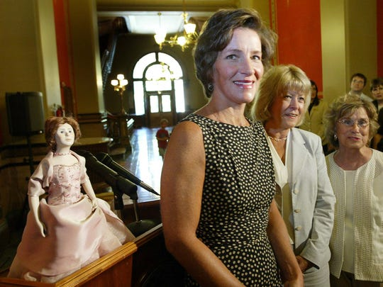 Iowa First Lady Mari Culver is joine by former first ladies of Christie Vilsack (middle) and Billie Ray during an event where they saw the unveiling of Culver's commemorative doll, seen at left, which was to be placed in a case on the first floor of the Statehouse, Monday morning, July 16, 2007. (JOHN GAPS III/The Register)