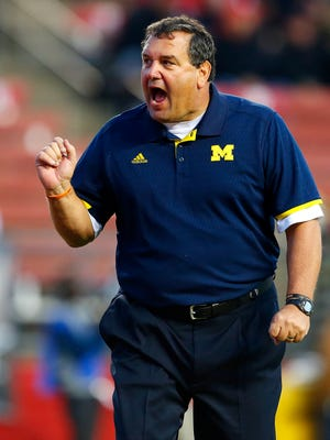 This Saturday, Oct. 4, 2014 file photo shows Michigan head coach Brady Hoke looking on during pregame warmups before their NCAA college football game against Rutgers in Piscataway, N.J.