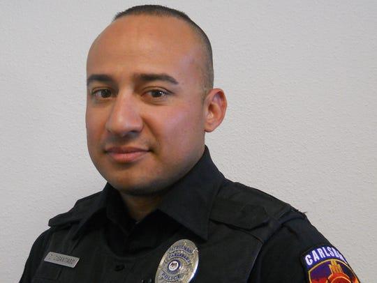 Carlsbad police Cpl. David DeSantiago is recognized