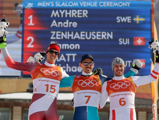 Silver medalist Ramon Zenhaeusern, of Switzerland, left, gold medalist Andre Myhrer, of Sweden, and bronze medalist Michael Matt, of Austria, celebrates during the venue ceremony after the men's slalom at the 2018 Winter Olympics in Pyeongchang, South Korea, Thursday, Feb. 22, 2018. (AP Photo/Morry Gash)