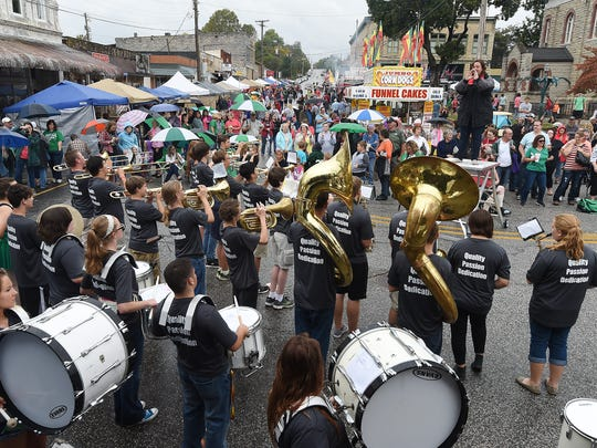 The Yellville High School band performs at the 70th annual Turkey Trot on Friday.