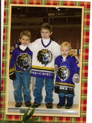 A family Christmas card of the Hughes brothers --
