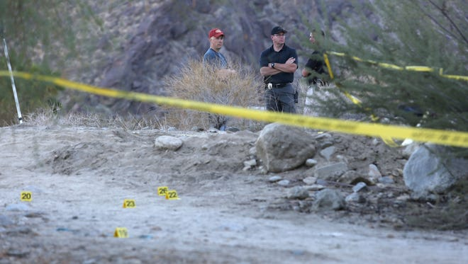 Jay Calderon/The Desert Sun Police investigate an area of desert Thursday near Ramon Road and Cahuilla Road in Palm Springs. A 15-year-old girl, who told authorities she had been abducted and sexually assaulted after she went out on a run, was found in the vacant lot early Thursday by a passerby. Police investigate an area of desert near Ramon and Cahuilla Rd where a sexual assault may have happened, Thursday, October 2, 2014.