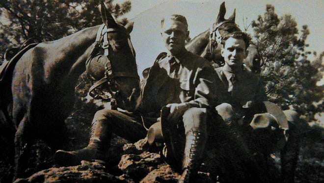 A town kid who had to learn to ride a horse, John Dvergsten, left, and a friend relax in the Black Hills of South Dakota while stationed with the 4th Cavalry in 1941.