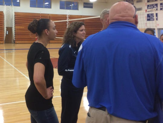 Lee High assistant coach Whitney Vaughn, left, was