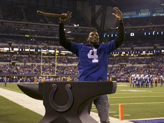 Indiana Pacers' guard Victor Oladipo strikes the anvil at the Indianapolis Colts game December 14, 2017
