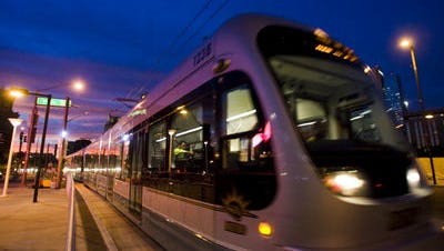 A light rail train travels on Jefferson Street in downtown Phoenix. Construction companies, engineering firms and transit service providers are the biggest early supporters of the Prop 104 campaign to expand Phoenix transportation.