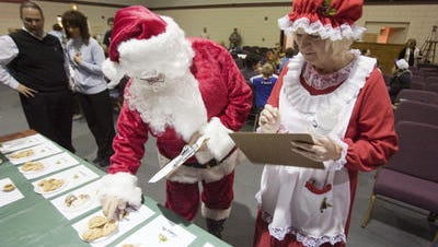 Randy White as Santa and Cindy Doran as Mrs. Claus judged a cookie contest at Christmas at the River in 2009. This year's event is Dec. 12.