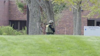 Police in tactical gear and carrying assault rifles surrounded North Central Health Care in Wausau on Thursday May 12 where a man with a weapon was reported. The campus was locked down, and 40 officers responded to clear the campus.