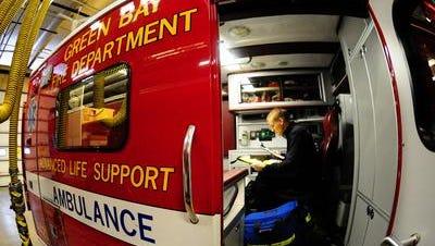 A paramedic inside a Green Bay Metro Fire Department ambulance.