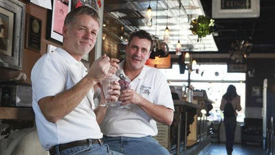 Roy and Tim Koons-McGee at the Westport Village store in late 2010.