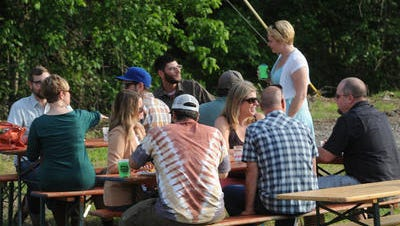People relax during the VIP party during Asheville Beer Week. The Salvage Station hosted the event in May, and will open to the public in September.