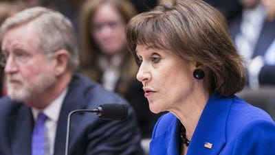 Lois Lerner, ex-director of the Tax Exempt and Government Entities Division at the IRS, declines to answer questions from Rep. Darrell Issa.