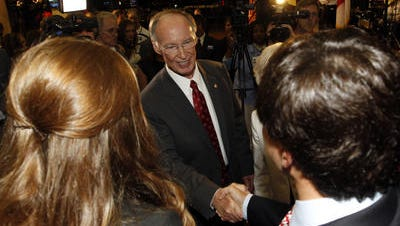 Gov. Robert Bentley shakes hands with supporters at his election primary viewing party Tuesday night at Bryant-Denny Stadium in Tuscaloosa. Bentley easily won the Republican nomination for governor with 89 percent of the vote with 98 percent of precincts reporting.