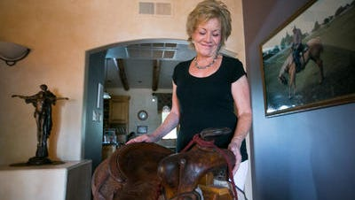 Donna Bird with her husband's much-loved saddle.