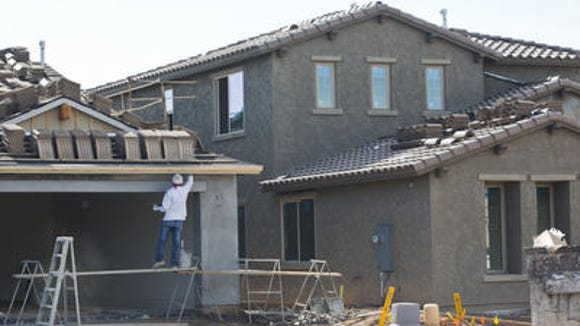 One of relatively few new homes being built this year in the Valley, this one in the Eastmark development in east Mesa