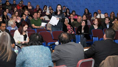Maureen Cassidy, a Kinry Road Elementary School parent, discusses the Wappingers Central School District facilities advisory committee report at a public hearing  in April at Roy C. Ketcham High School, where about 200 people were in attendance.