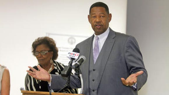 Incoming schools Superintendent Kenneth Hamilton speaks at the Mount Vernon Education Center. Behind him is Judith Johnson, the outgoing interim superintendent.