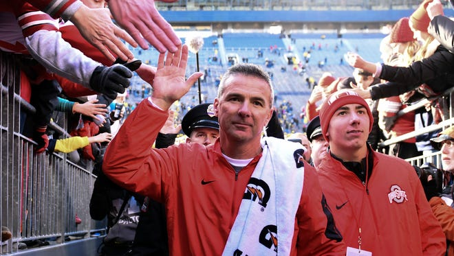 Ohio State Buckeyes head coach Urban Meyer walks off the field after the game against the Michigan Wolverines at Michigan Stadium. Ohio State won 42-13.