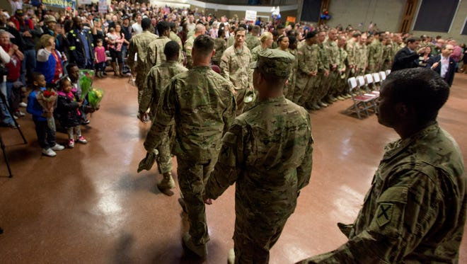 The 217th Military Police Co., an Alabama Army National Guard unit, returns to Prattville, Ala. on Friday March 4, 2016 after being deployed for nine months as part of Operation Freedom's Sentinel.
