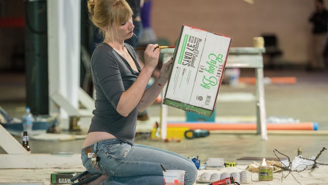 Artist McKenna Graham paints a box, an element in her piece for Louisville Visual ArtÕs Instant Installation Invitational iii Spring Meet at their new facility at 1538 Lyle St., in the Portland neighborhood. May 19, 2016