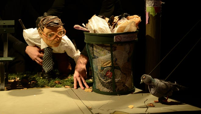 """Frank spies on one of the pigeons in the park, which he is convinced are plotting against him, in """"The Pigeoning""""at OZ Arts Nashville."""