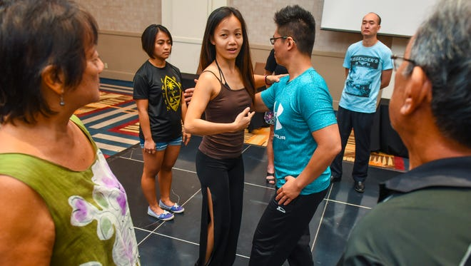 Dance instructors, Starlinn Choo and Steven Hoe, from Singapore's ACTFA School of Dance and Performing Arts, offers tips in proper position and dance steps of Latin dancing during a class at the Sheraton Laguna Guam Resort in Tamuning on Friday, April 27, 2018. The class was being offered as part of the Guam Latin Dance Festival, with activities scheduled from Friday, April 27 through Monday, April 29.