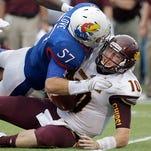 Kansas linebacker Jake Love sacks Central Michigan quarterback Cooper Rush during the second half.