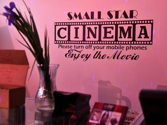 A sign behind the counter at Small Star Art House asks patrons to turn off their cell phones before entering the theater. Small Star opened in March on West Market Street in York's WeCo neighborhood. Owner Patti Stirk says the cinema, which seats 22 people, shows the kind of independent films and documentaries not shown at the local multiplex.