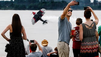 May 28, 2016 - Brad Teplicky (cq) (right) takes a selfie picture during an airshow at the Memphis in May International Festival's 901 Fest, a celebration of all things Memphis in Tom Lee Park Saturday afternoon. Hundreds of festival goers enjoyed the talents of local musical groups during the Memphis in May replacement event for the Sunset Symphony, which ended its 39-year run last year.   (Mark Weber/The Commercial Appeal)